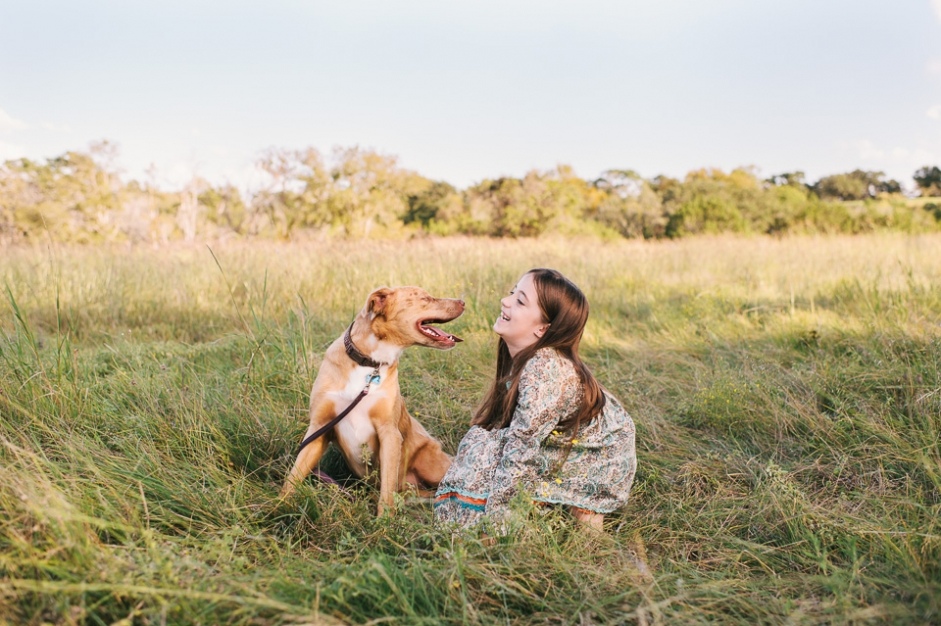 family portrait session photo of girl with dogs
