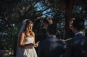 bride standing in bright sunlight